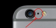 Why is there a small hole between the camera and flash of your iPhone?