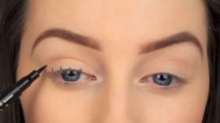 She had drawn several spots just above the lashes. It looked odd, until she did THAT! 1