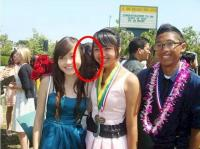 6. Among the girls you can see a third girl who is also posing for the photo ...