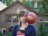 3. Seconds before the photograph, the girl prepares to receive the ball