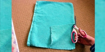 She started to cut her old towel with a pair of scissors. She made something we all need to have in our bathrooms!